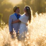 Bride and Groom in a sun drenched meadow of golden grasses at Bell Valley Retreat — Anderson Valley, Mendocino County, California
