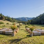 Hay bales set out for wedding guests under a blue sky at Bell Valley Retreat — Anderson Valley, Mendocino County, California