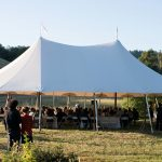 The wedding tent in a sunny meadow at Bell Valley Retreat — Anderson Valley, Mendocino County, California