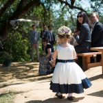 the flower girl proceeds down the dirt path at Bell Valley Retreat — Anderson Valley, Mendocino County, California
