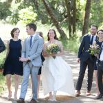 A wedding party walking up the dirt road at Bell Valley Retreat — Anderson Valley, Mendocino County, California