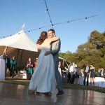 Bell Valley Retreat Wedding with Couple Dancing and wedding tent in background — Anderson Valley, Mendocino County, California