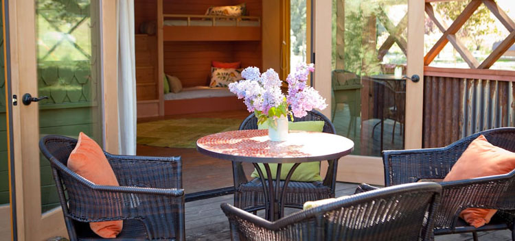 outdoor seating on the patio of the Bunkhouse at The Toll House at Bell Valley Retreat in Anderson Valley, Mendocino County, California