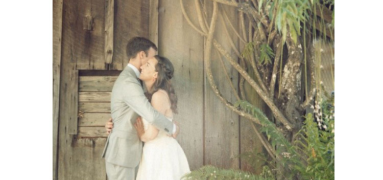 a couple embrace at The Toll House at Bell Valley Retreat in Anderson Valley, Mendocino County, California