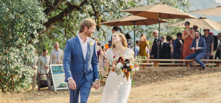 a laughing couple during their wedding at The Toll House at Bell Valley Retreat in Anderson Valley, Mendocino County, California