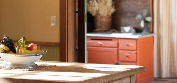 the sun lands on the butcher block in the kitchen of the Toll House at Bell Valley Retreat