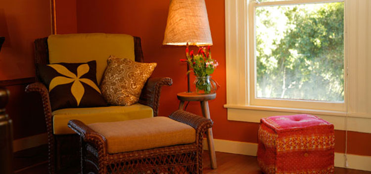 a comfy chair by a window at The Toll House at Bell Valley Retreat