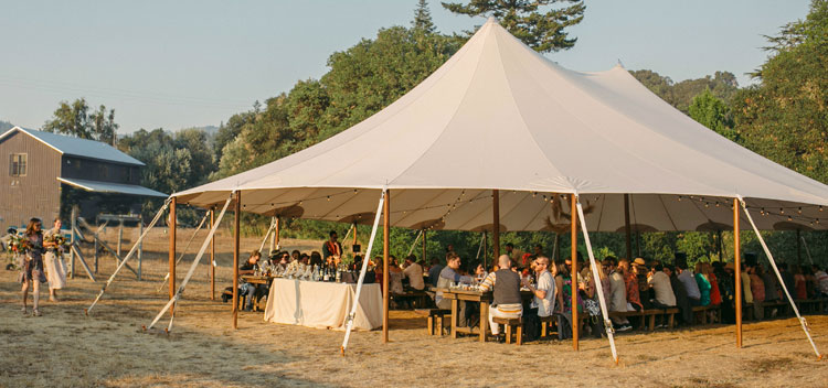 tent shelters wedding guests at dinner at Bell Valley Retreat