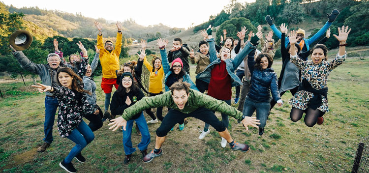 happy retreat-goers leap into the air