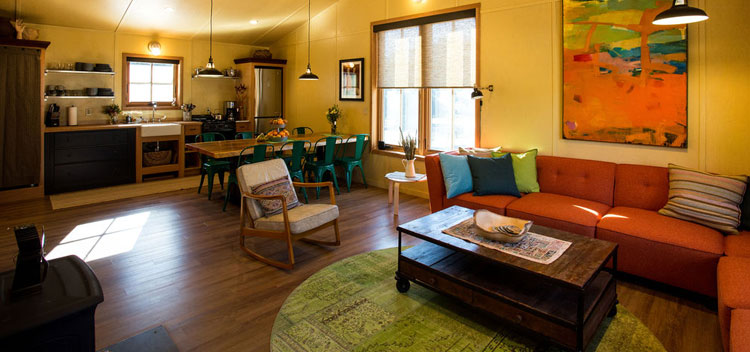 the barn living space with modern, colorful furnishings