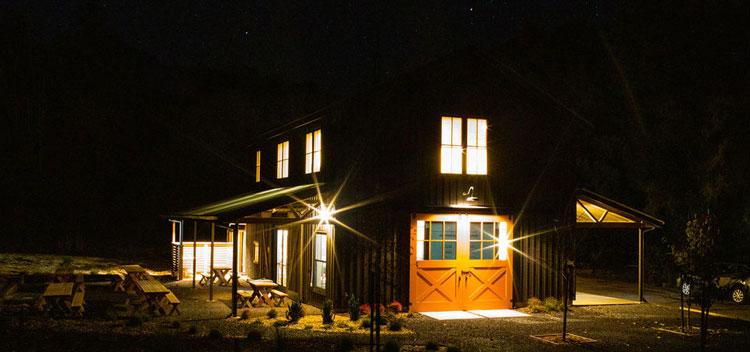 the barn illuminated at night